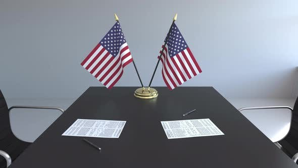 Thumbnail for Flags of the United States and Papers on the Table