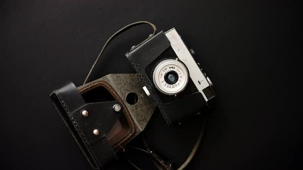 Thumbnail for Old Retro Film Camera in Leather Case on Black Background