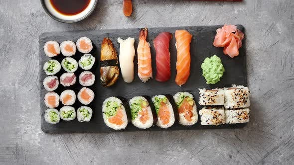 Thumbnail for Composition of Different Kinds of Sushi Rolls Placed on Black Stone Board