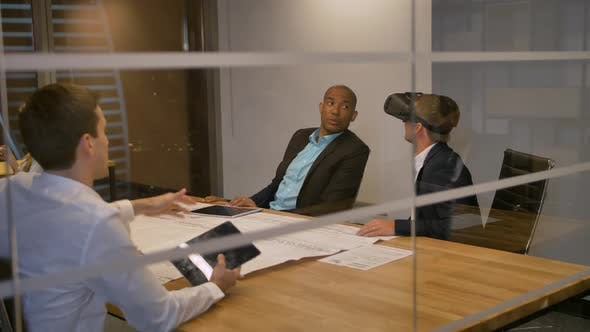 Thumbnail for Businessman in VR Headset with Colleagues
