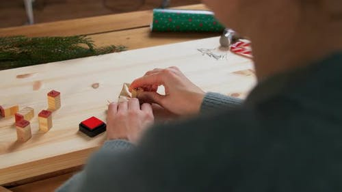 Woman Making Advent Calender on Christmas at Home