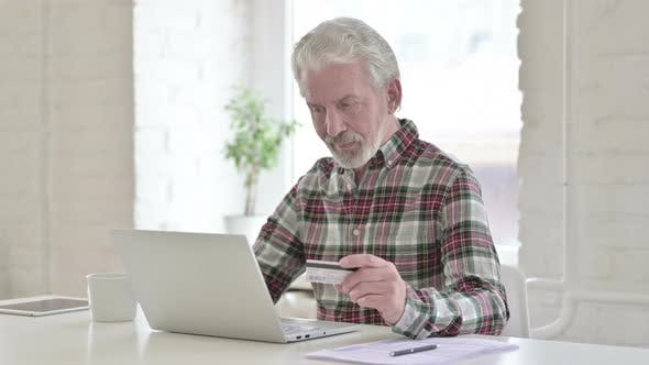 Thumbnail for Online Payment on Laptop By Old Male Designer