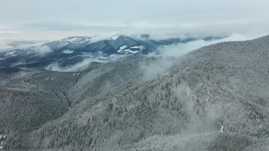 Thumbnail for Aerial View. Scenic Mountain Landscape on a Winter Day, Fog in the Low Areas