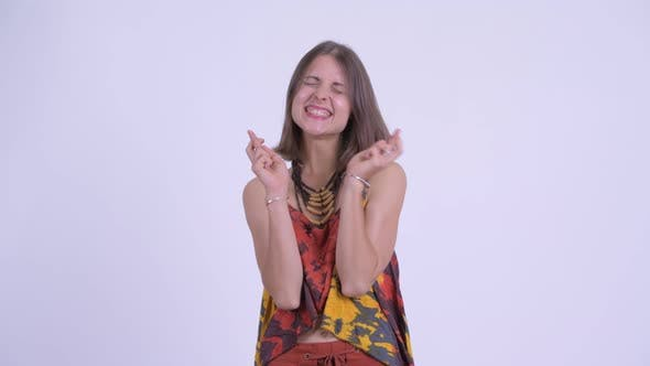 Thumbnail for Happy Young Beautiful Hipster Woman Wishing with Fingers Crossed