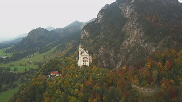 Thumbnail for AERIAL: View of Neuschwanstein Castle in Mountains, Summer, Sunny
