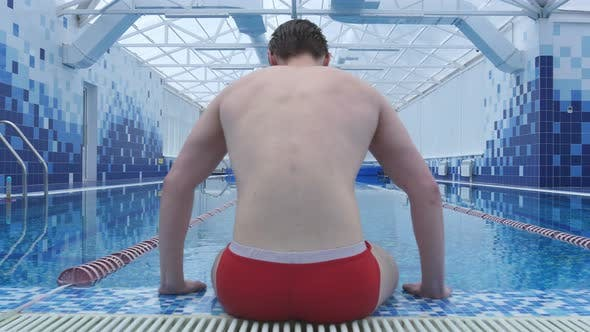 Thumbnail for Young Man Sitting By the Swimming Pool
