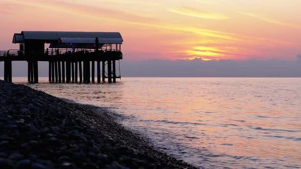 Thumbnail for Panorama of the Sunset Over the Sea Next To the Silhouette of the Pier.