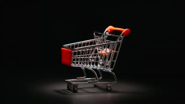 Thumbnail for Shopping trolley is rolling to a center of stage