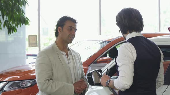 Thumbnail for Handsome Mature Man Choosing a New Automobile at the Dealership