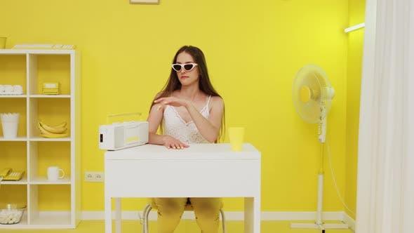 Woman In Stylish Sunglasses Is Listening Music