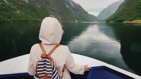 Thumbnail for Tourist on the Bow of a Cruise Ship Admires the Spectacular Fjords of Norway