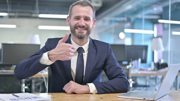 Thumbnail for Cheerful Young Businessman Showing Thumbs Up