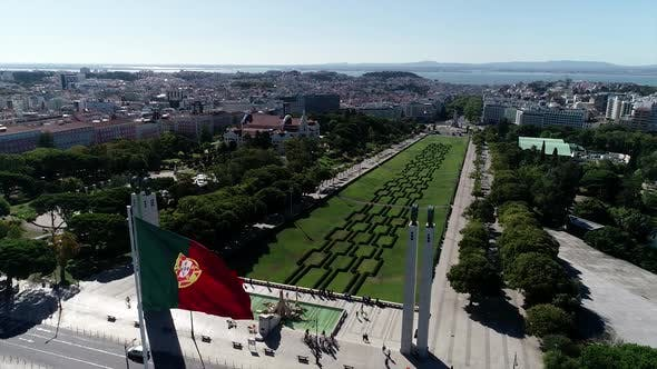 Thumbnail for Portuguese Waving Flag In Eduardo VII Park In Lisbon, Portugal Aerial View