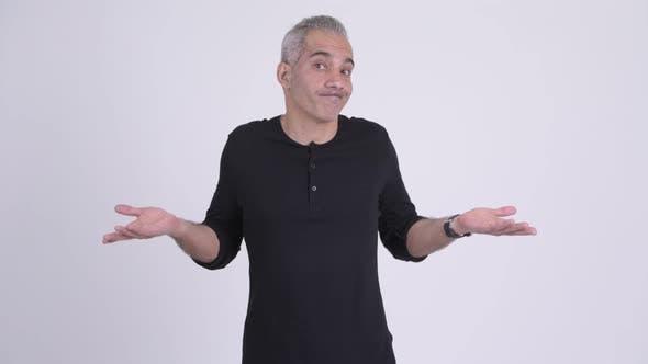 Handsome Persian Man Shrugging Shoulders Against White Background