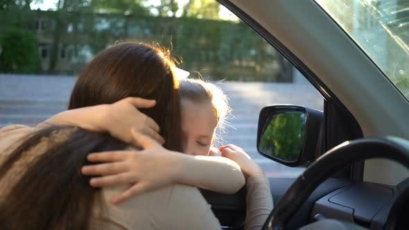 Thumbnail for Young Mother in a Car Seeing Her Daughter Off To School