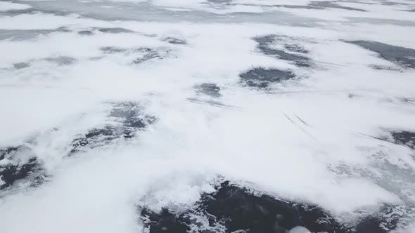 Thumbnail for Aerial Drone View Flying High Above Frozen Ice Lake In Winter 4