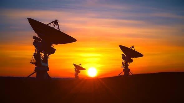 Thumbnail for Three Radio Telescopes Against Scenic Sunset Exploring Evening Sky