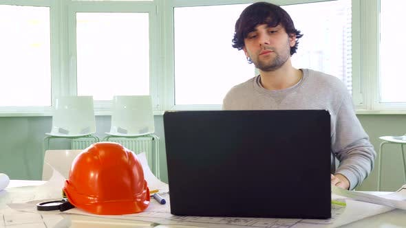 Thumbnail for Architect Closes the Laptop at the Office