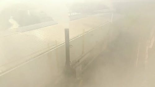 Aerial view of factory with pipes with white smoke emission 02