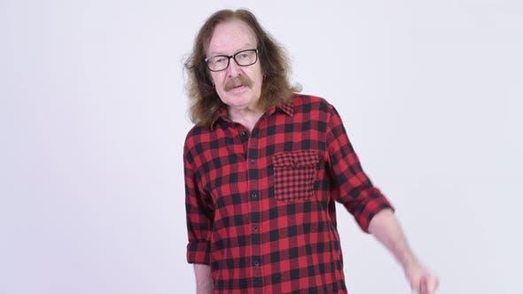 Thumbnail for Angry Senior Hipster Man Giving Thumbs Down