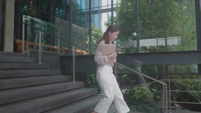 young Asian women walking for work at co-working space modern office