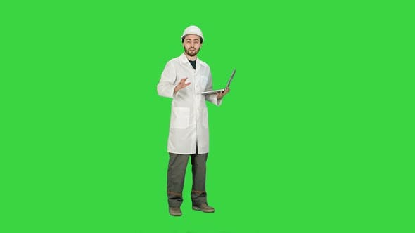 Thumbnail for Technical Working in Helmet Talking on Camera Hand Gestures  on a Green Screen, Chroma Key