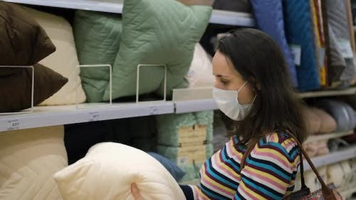Woman Shopping for Bedding at Furniture Store