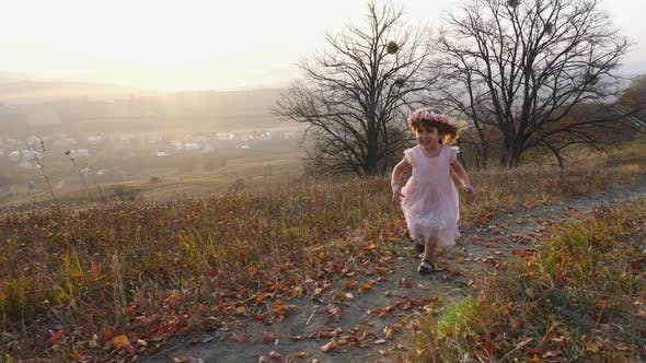 Thumbnail for Girl running on a hill
