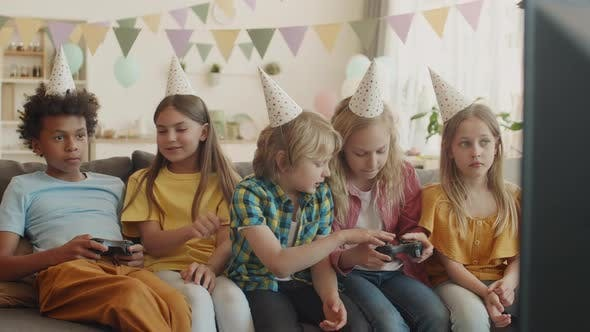Thumbnail for Children Playing Video Games