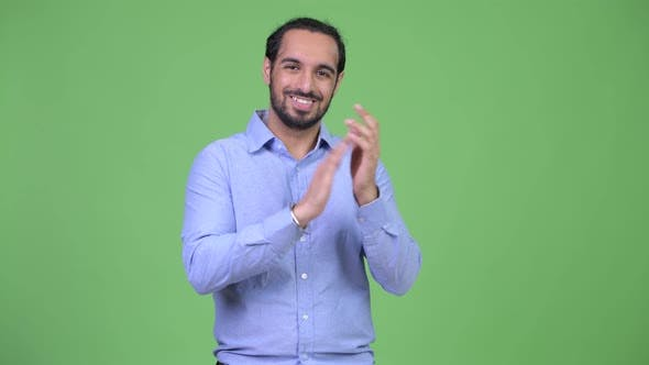 Young Happy Bearded Indian Businessman Clapping Hands