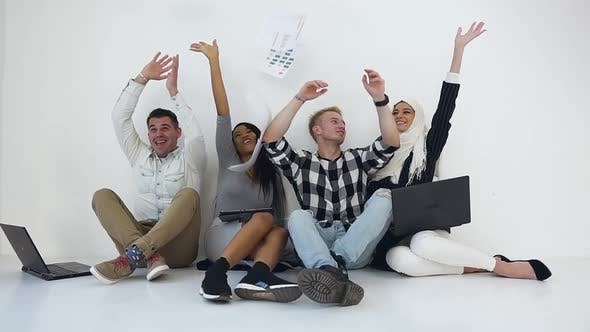 Thumbnail for Mixed Race Office Team throw Up a Lot of Papers and Giving High Five