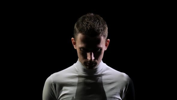 Cover Image for Front View of a Man in White Clothes Looking Down and Set Up Psychologically To Start the