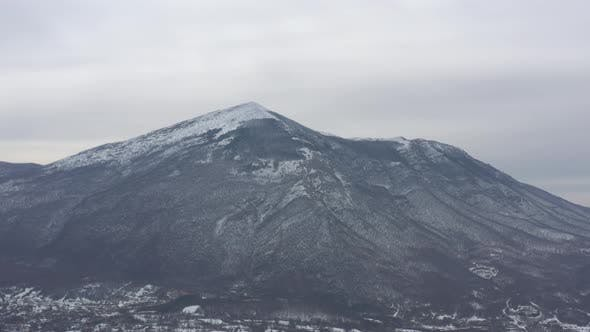 Thumbnail for Peak of Rtanj mountain under snow 4K aerial video