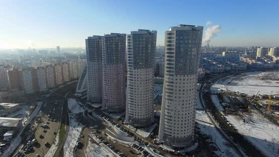 Four Identical Skyscrapers on a Megalopolis Background