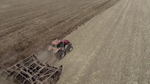 Thumbnail for Farmer in Tractor Preparing Land with Seedbed Cultivator