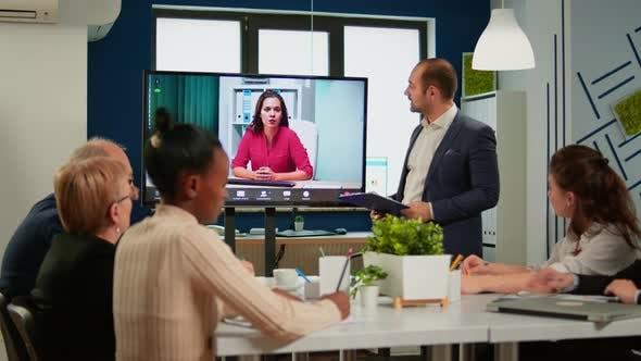 Diverse Business Team Having Videomeeting in Broadroom