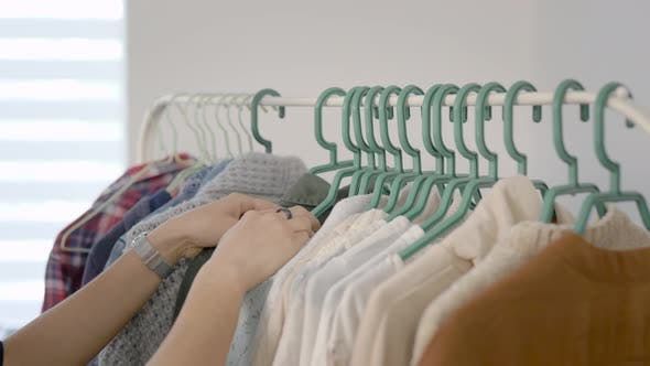 Thumbnail for Women Are Studying Clothes Hung on a Hanger. Choosing a Wardrobe Is Very Important for Modern Women