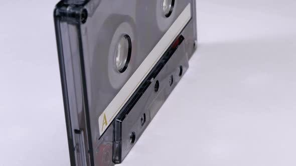 Thumbnail for Vintage Transparent Audio Cassette Rotates on White Background