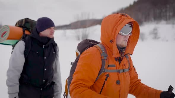 Thumbnail for Portrait of Two Guys Trekking in Winter. High Active Sportsmens in Nature.