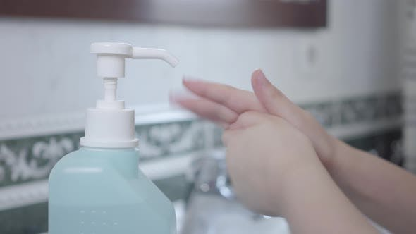 Thumbnail for Male Hand Pushing Hand Sanitizer for Little Girl. Father Taking Care of Daughter's Health During