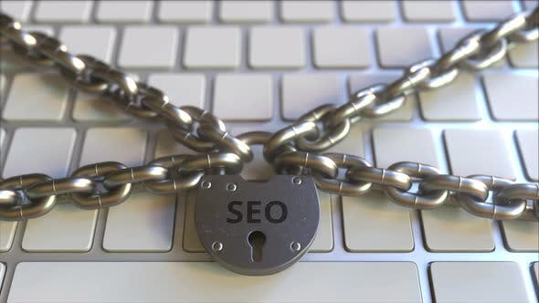 Thumbnail for Chains and Padlock with SEO Text on the Keyboard