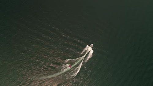 Boat Pulling Kids On Inner Tubes Overhead