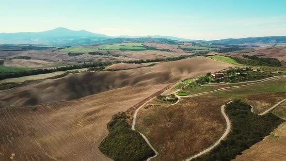 Thumbnail for AERIAL View of fields in hilly landscape / Tuscany, Italy