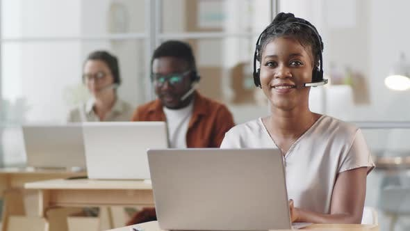 Thumbnail for Portrait of Cheerful Afro-American Woman at Work in Call Center