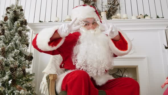 Thumbnail for Santa Claus Showing a Victory Sign with Both Hands