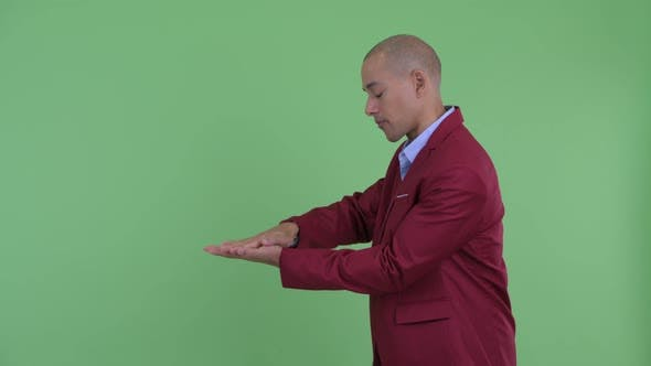 Thumbnail for Happy Bald Multi Ethnic Businessman Snapping Fingers and Showing Something