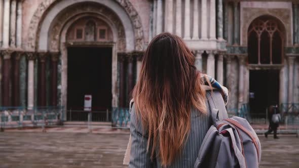 Thumbnail for Woman Tourist with Backpack Walking To Old Antique Building in Venice Italy