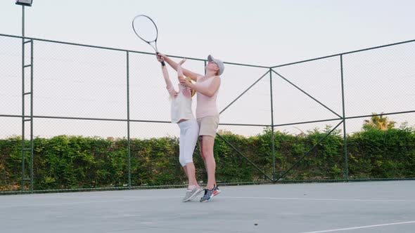 Thumbnail for Mom Is Trying To Teach To Play Tennis. Family Activities