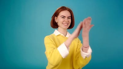 Smiling Lady Claps Hands