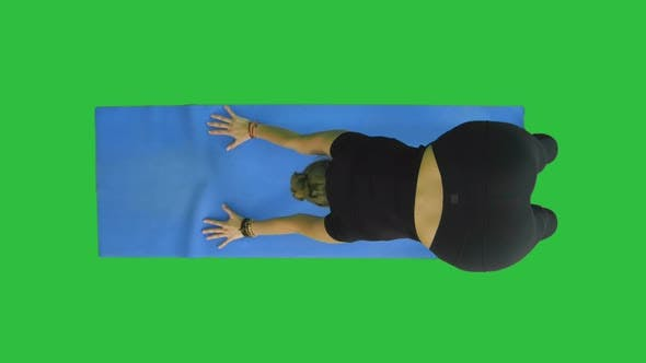 Thumbnail for Healthy Yoga Woman Does Stretch on Mat on a Green Screen, Chroma Key